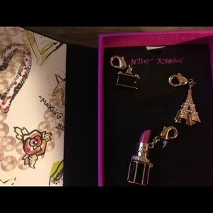 Betsey Johnson Necklace with charms.